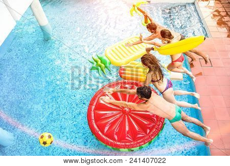 Top View Of Active Friends Jumping At Swimming Pool Party - Vacation Concept With Happy Guys And Gir