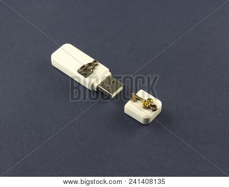 White Flash Drive With A Key And A Lock On A Blue Background