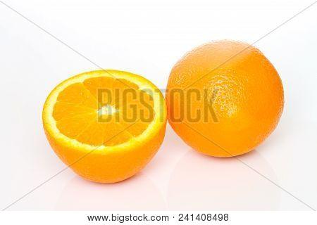Pieces Of Orange Fruit On White