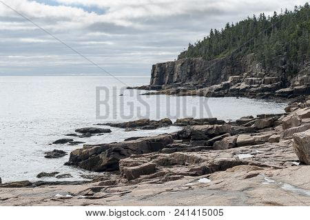 Rocky Shoreline Below Otter Cliff In Acadia National Park On Cloudy Day In Late Summer