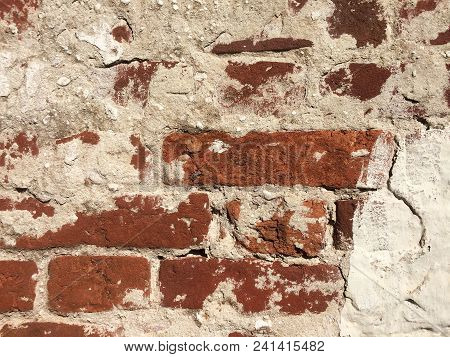 Old Crack Brick Wall Texture. Grunge Ancient Architecture Surface. Vintage Textured Material Backgro