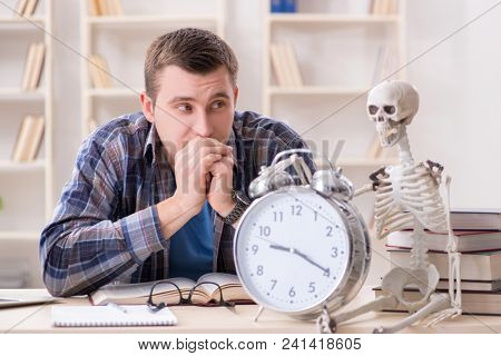Student and skeleton preparing for school exams