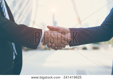 Two Confident Businessman Shaking Hands. Successful Business Partners. Negotiating Business. The Bus