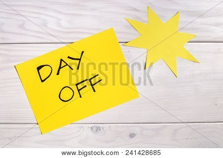 Text Day Off And Sun Shape On Wooden Table.