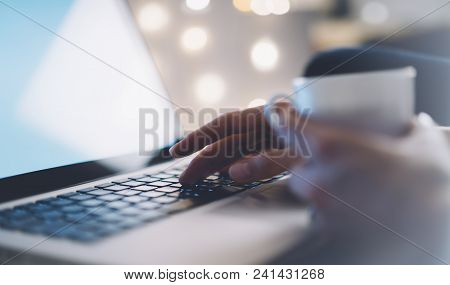Closeup Female Freelancer Sitting Front Open Laptop Computer With Blank Screen Blue Monitor With Cup