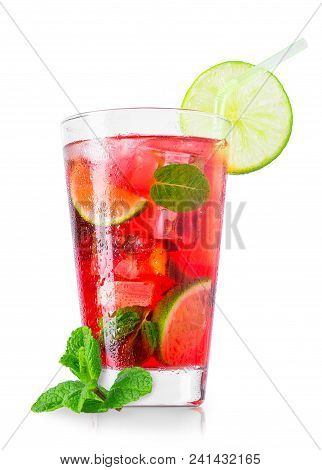 Wet Glass Of Cold Red Cocktail With Fruit Juice, Slices Of Lime, Leaves Of Mint, Cubes Of Ice And St
