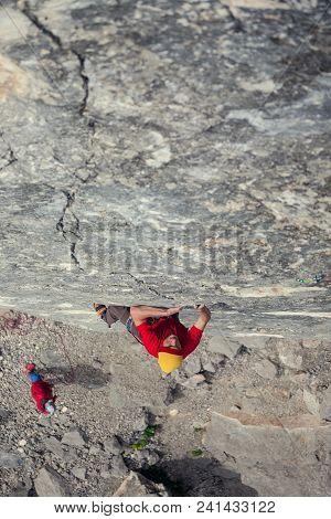 A Man Climbs The Rock.