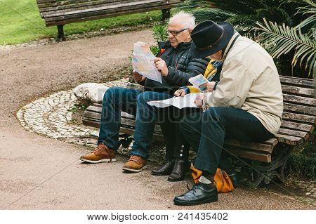 Lisbon, Portugal 01 May 2018: Pensioners Or Elderly People Plan Voyage In Lisbon. Tourists Pensioner