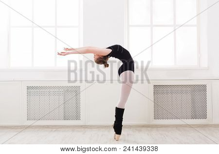 Young Graceful Ballerina In Black At Ballet Class Making Croise. Classical Dancer In White Hall Prac