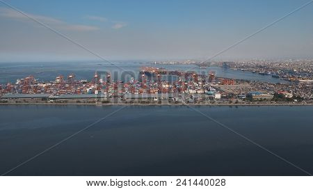 Aerial View Industrial Cargo Port With Ships And Cranes, Manila. View Of The Cargo Port And Containe
