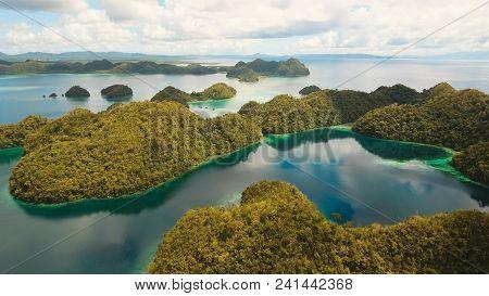 Aerial View: Beach, Tropical Island, Sea Bay And Lagoon, Siargao. Tropical Landscape Hill, Clouds An