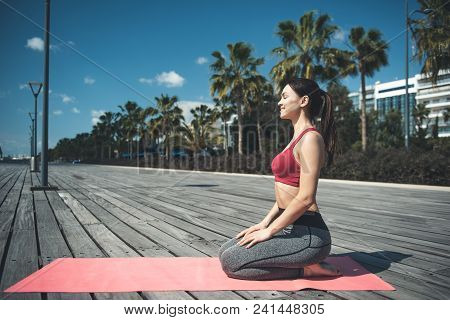Full Length Side View Happy Woman Relaxing On Mat On Open Air After Gymnastic Exercise. Positive Lad