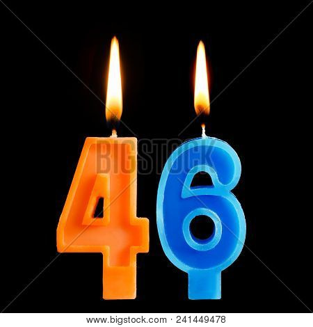 Burning Birthday Candles In The Form Of 46 Forty Six For Cake Isolated On Black Background.
