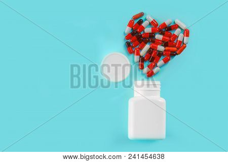 Medicine Pills, Tablets And Capsules For The Treatment Of Heart Disease. Heart Shape And Bottle Of P