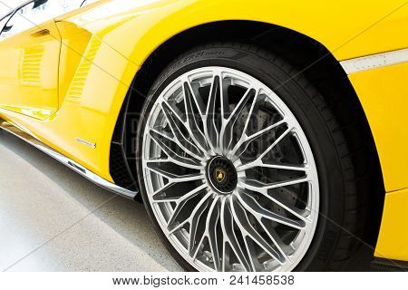 Berlin, Germany - April 15 2018: Lamborghini Company Logo On Lamborghini Aventador S Coupe Standing