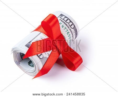 Concept, Money As Gift, Win Or Bonus. 100 Dollar Bills Are Twisted Into Tube And Tied With Red Ribbo