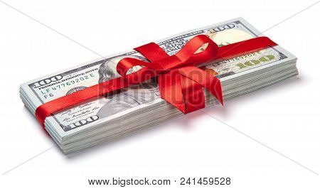 Concept, Money As Gift, Win Or Bonus. Pile Of 100 Dollar Bills Is Tied With Red Ribbon With Bow. Iso