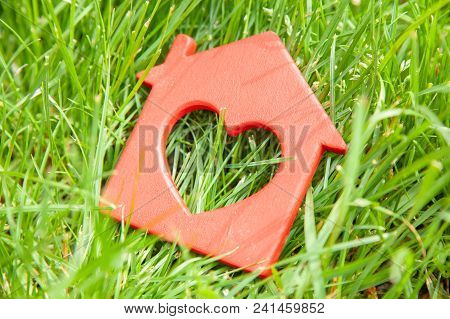 Sweet House In The Grass. Concept Of Eco House, Cottage. Symbol Of  House With Heart On Green Summer