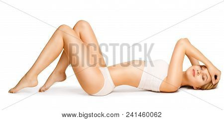 Body Beauty, Slim Woman In Cotton Underwear Lying Down On Back, Happy Dreaming Girl Isolated Over Wh