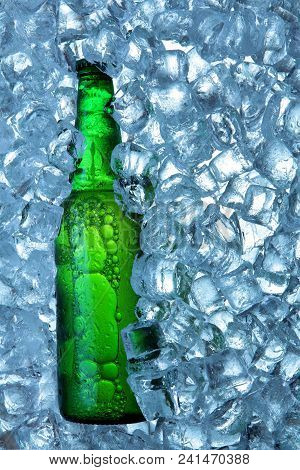 Bottle Of Beer In Ice Cubes.closeup.green Bottle.hot Summer Fresh Drink.copy Space