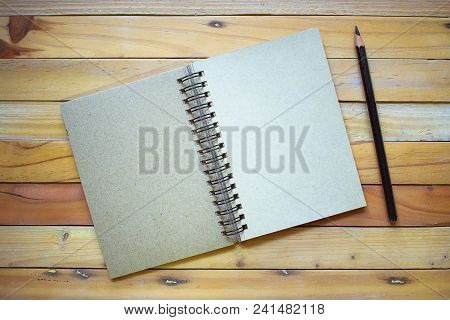 Notepad With Pencil On Wood Board Background.using Wallpaper For Education, Business Photo.take Note