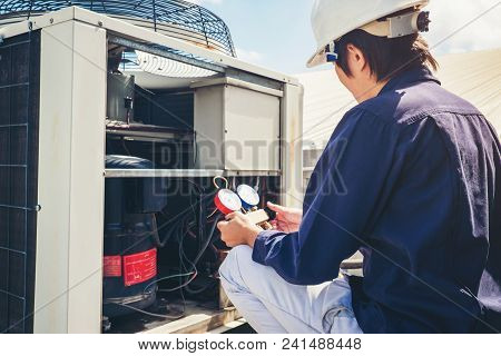 Technician Is Checking Air Conditioner Concept Repair