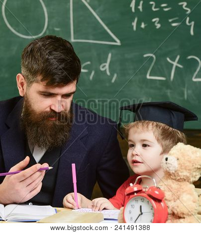 Kid Studies With Teacher, Listening With Attention. Elementary Education Concept. Teacher And Pupil