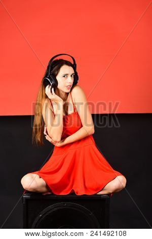 Pleasure, Music And Creative Lifestyle Concept. Singer With Interested Face Listens To Music. Dj Sit