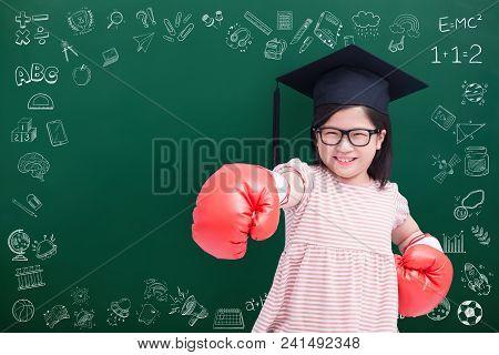 Cute Girl Wear Bachelor Cap With Glove On Green Chalkboard
