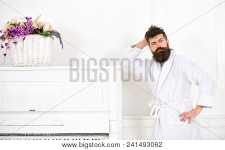 Talented Musician Concept. Man With Beard In Bathrobe Enjoys Morning While Standing Near Piano. Man