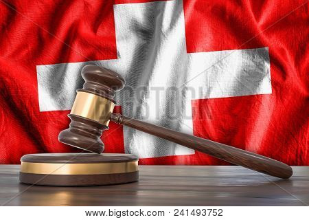Wooden Gavel And Flag Of Switzerland On Background - Law Concept. 3d Rendered Illustration.