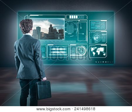Developer Watching Informational Data On A Hologram Screen In Office.