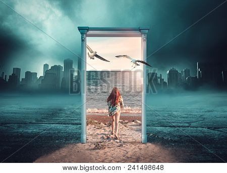 Young Girl Running Through A Door Leading To A Tropical Beach In A Background Of Dark And Cold City.