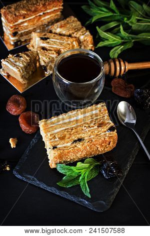 Cake With Cream And Dried Fruits. The Medovik. Cake And A Cup Of Espresso. Honey Cake With Dried Fru