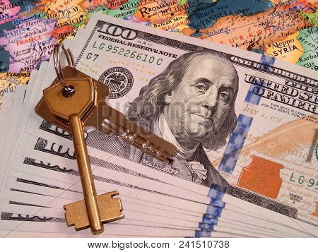 Dollars And A House Key On A Europe Map. Sale And Purchase Of Real Estate In The Eu, Estate Investme