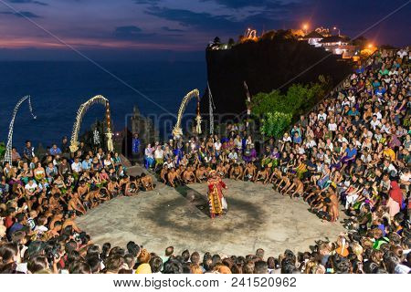 Bali, Indonesia - September 19: Unidentified tourists watch traditional Balinese Kecak Dance at Uluwatu Temple on Bali, Indonesia. Kecak is very popular cultural show on Bali.