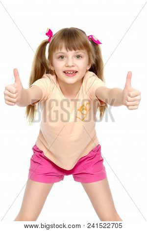 Little Girl Holding Her Thumb Up. Concept Happy Childhood, Holiday, Birthday.isolated On White Backg