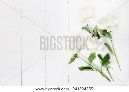 Styled Stock Photo. Feminine Wedding Table Composition With White Peonies Flowers On Old White Woode