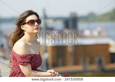 woman portrait outdoor. cute young girl in summer. Young smiling woman outdoors portrait. Soft sunny colors.Close portrait. Fashionable young woman outdoors portrait glamour girl at city street