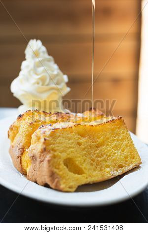 Beautiful Short-cake, Ice-cream And Maple Syrup Set On The Table