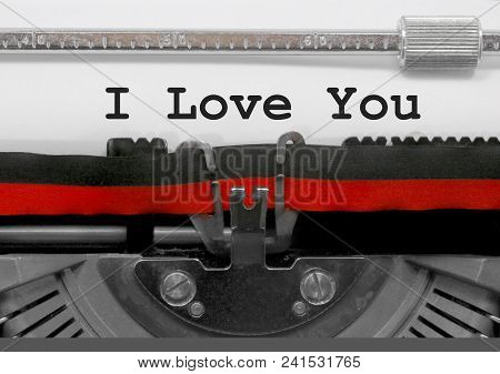 I Love You Text Written By An Old Typewriter On White Sheet