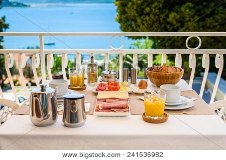 Continental Morning Breakfast Table Setting With Sea View Is Served.