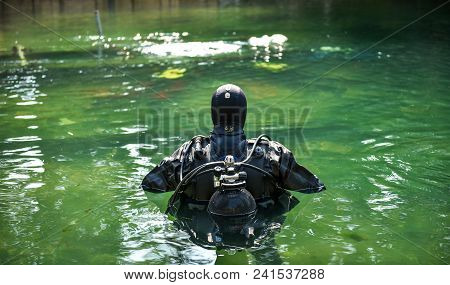 Scuba Diver Worker Is Over Viewing Underwater Archaeology Works.