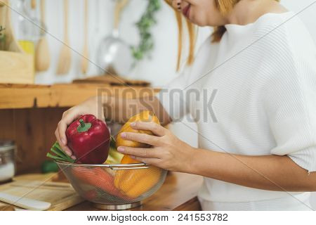 Asian Woman Making Healthy Food Standing Happy Smiling In Kitchen Preparing Salad. Beautiful Cheerfu