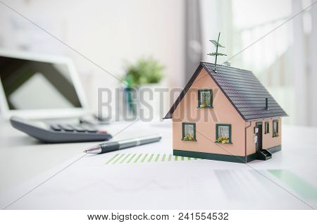House Model On Desk, Mortgage, Investment Or House Building Concept