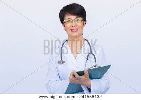Medical Physician Doctor Woman Over White Clinic Background.