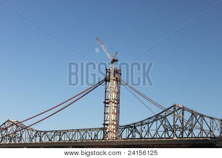 Crane holding up the moon