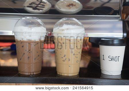 Iced Coffee Latte And Iced Coffee Mocha On Wood Table