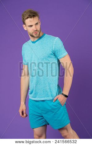 Sportsman In Tshirt And Shorts On Violet Background. Man In Blue Casual Clothes. Macho In Active Wea