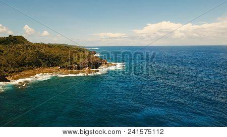 Rocky Coast Line Of Island Siargao. Aerial View Sea Rocky Coast, Waves Breaking To The Rocky Shore.